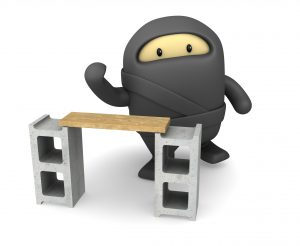 Cute little ninja prepares to chop wood plank.This cute little ninja could be a useful element in a cartoon composition.  This is a detailed 3d rendering.