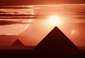 Landscape of a distant world with several planets and egyptian style pyramids.