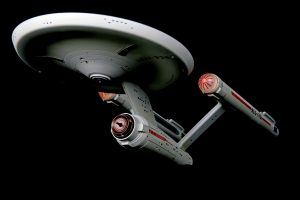 Vancouver, Canada - March 25, 2014:A model of the Federation starship USS Enterprise, commanded by Captain James T. Kirk in the original Star Trek series. The model is made by Art Asylum and released by Diamond Select.