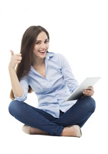 Woman holding digital tablet and showing thumbs up