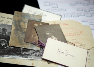 A selection of old photographs, certificates and In Memoriam cards