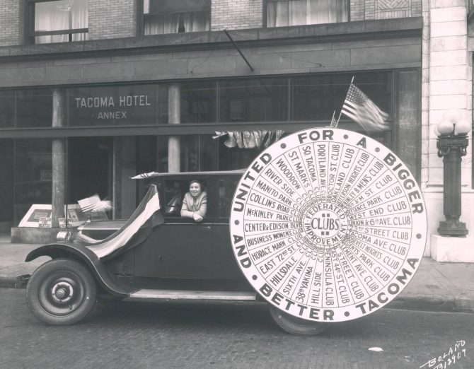 Image of a car with a Federal Improvement Club ad